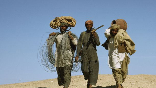 <p>Workers carry industrial equipment from a natural gas facility in Baluchistan, Pakistan. The men are members of the Bugti tribe, an ethnic group native to Baluchistan, near Pakistan's border with Afghanistan.</p>