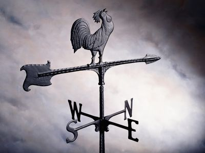 Photo: A traditional wind or weather vane with a rooster on top