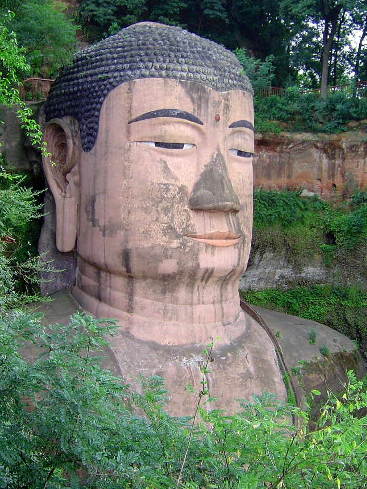 The Leshan Giant Buddha, in Sichuan, China, is the largest Buddha in the world. The statue is carved directly into the mountainside and measures 71 meters (233 feet) tall. The Leshan Giant Buddha is one of the most visible symbols of weathering caused by pollution. Nearby industrial development and a stream of tourists arriving by bus have caused chemicals in the air to corrode, or wear away, the delicate stone of the carving.