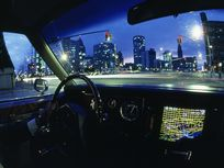 Photo: A car's dashboard features an electronic map.