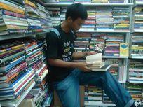 Photo of a boy reading a book.