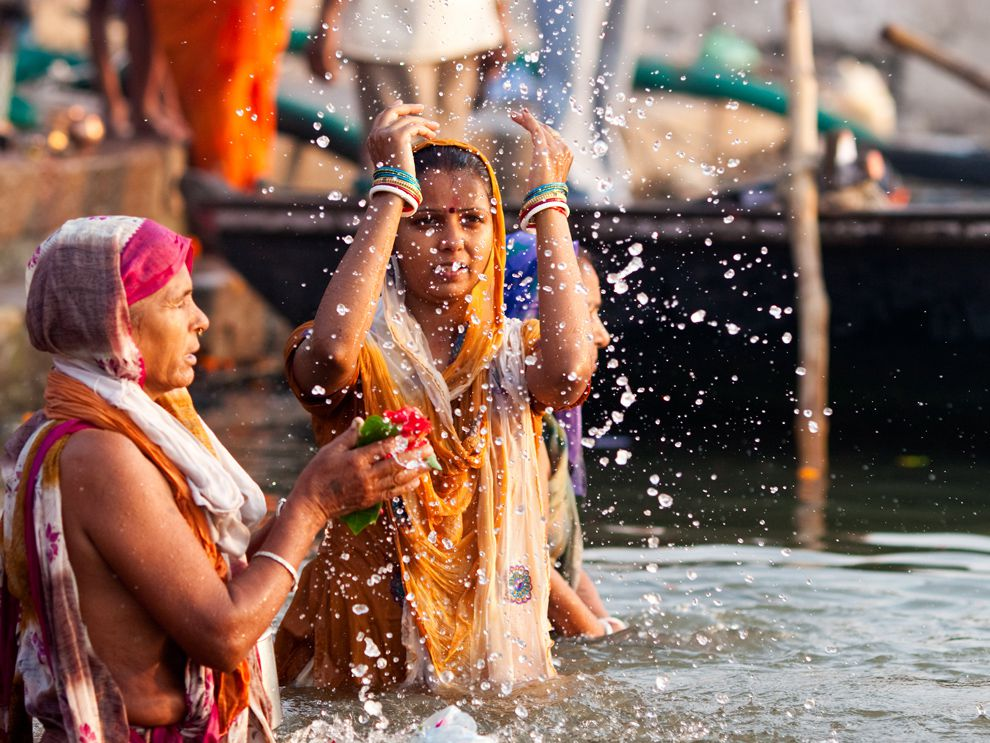 ff51e799986 The Ganges River is sacred to Hindus like these women in Varanasi, India.  Pilgrims travel thousands of miles to pray and bathe themselves in the river  as ...