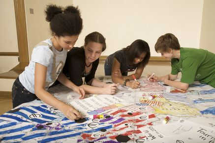 Photo: Students color a MapMaker Kit.