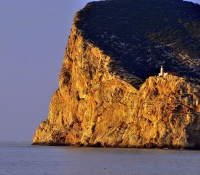 Photo: A sea cliff and lighthouse on the coast of Spain