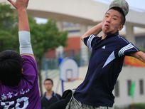Photo of a boy throwing a handball.