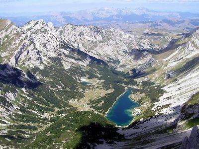 Photo: A drainage basin at the base of a mountain.