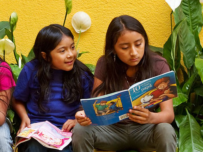 Photo of two girls reading.