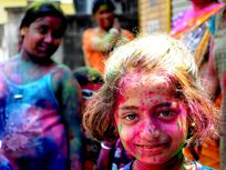 Photo of a girl covered in pink powder.