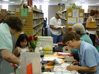 Photo of people in a library.