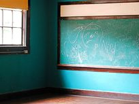 Photograph of a chalkboard in a classroom.