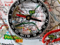 Photograph of a compass and map.