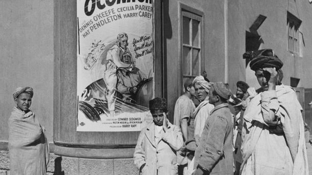 """<p class=""""p1"""">Afghanistan continued to be a crossroads of culture until the late 20th century. Here, a cinema in 1920s Kabul, Afghanistan, shows American and European films.</p>"""