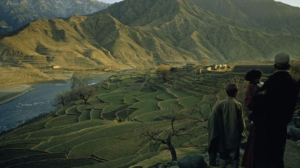 """<p class=""""p1"""">Local goods exchanged at Afghanistan's Silk Road trading posts included produce grown in the agriculturally rich valleys. Here, a farmer overlooks his terraced wheat field descending to the Kunar River.</p>"""