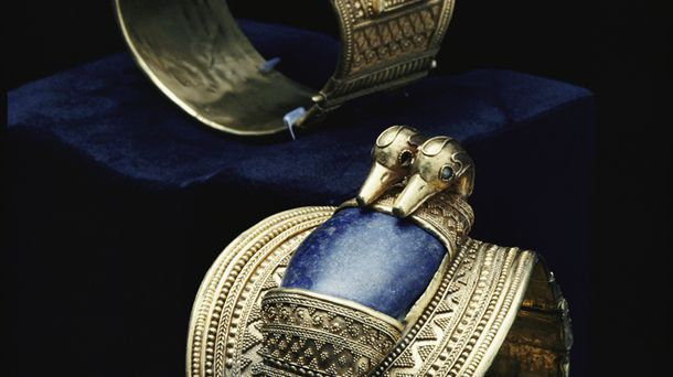 """<p class=""""p1"""">The bright blue lapis lazuli in these Egyptian gold bracelets may have been imported from Afghanistan, one of the only known sources of the stone.</p>"""
