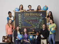 Picture of students around a chalkboard.