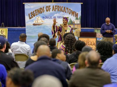 A woman presents on the legends of Africatown.