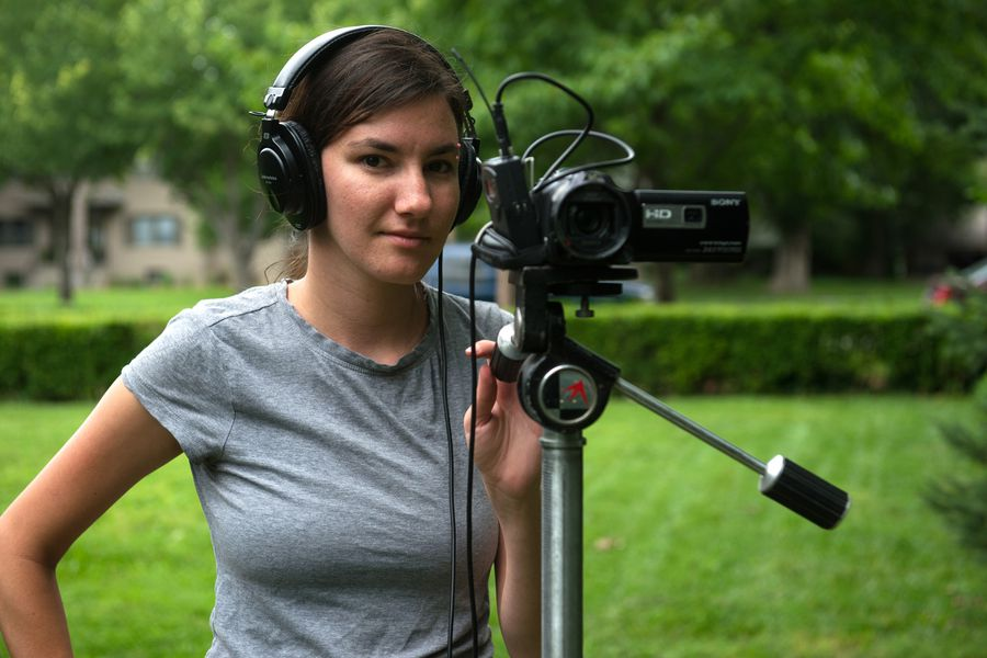 Picture of woman with mic and headphones