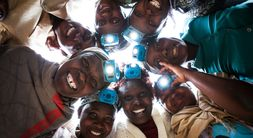 Picture of women in Rwanda with rechargeable Nuru Lights, created by Great Energy Challenge grantee Nuru Energy.