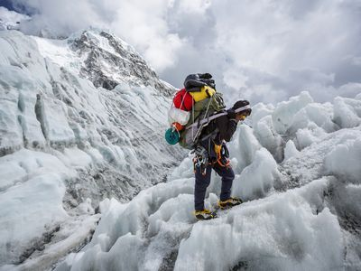 Khumbu Ice Fall, Nepal. A Sherpa packs down gear from Camp Two on Mount Everest.