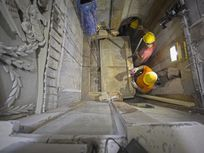 Workers remove the top of the suspected tomb of Jesus Christ in the Church of Holy Sepulchre in Jerusalem.