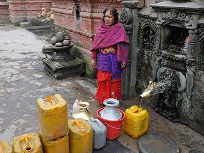 CXREBG Woman with jerry cans, water supply, Kathmandu, Kathmandu Valley, Nepal, Asia