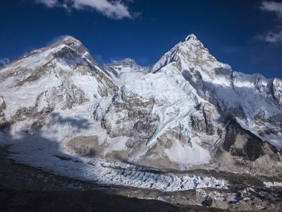 Mount Everest is the highest point on Earth standing at approximately 8,850 meters (29,035 Feet).