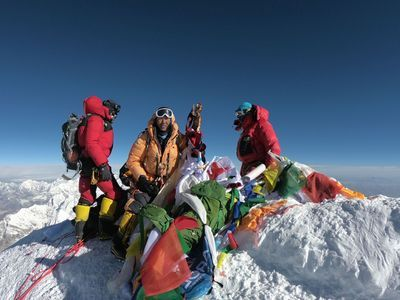 Mountaineers and sherpas perched on the peak of Mount Everest on May 17, 2018.