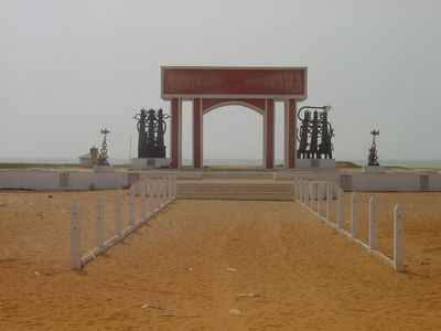 On the beach of the former slave port of Ouidah, Benin, stands the Door of No Return, a memorial arch dedicated to the enslaved Africans taken to the Americas.