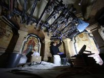 Members of the conservation team remove steel girders supporting the Edicule during restoration work, at the Church of the Holy Sepulchre in Jerusalem's Old City