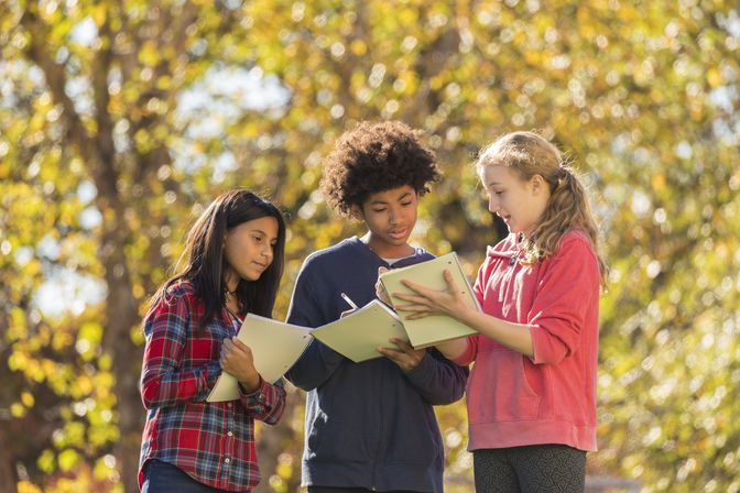 students outside sharing notes