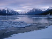 The Lewis Range and partially frozen Lake McDonald.