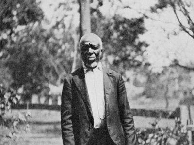 This photo, taken in 1914, is of Cudjo Lewis, the last remaining survivor of the transatlantic slave trade.