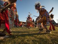 Participants dance in traditional regalia during the annual pow wow at the Crow Indian Reservation