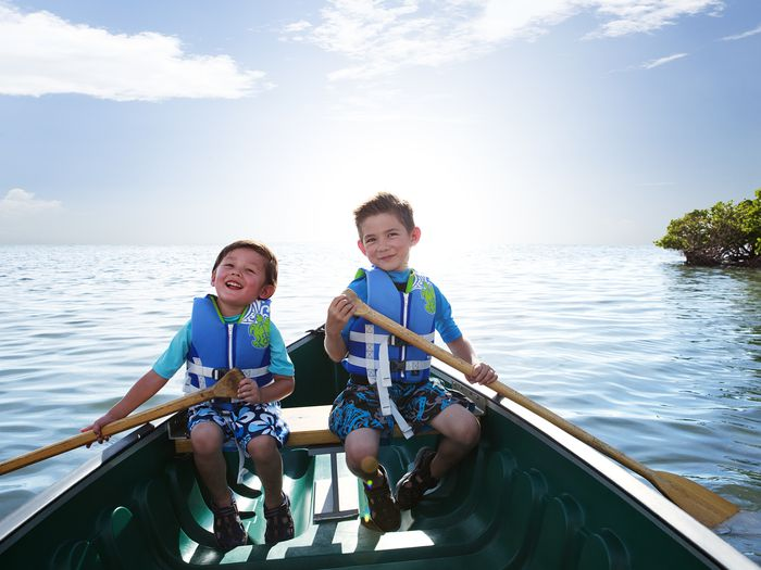 Brothers paddling a canoe