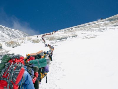 Mount Everest is becoming increasingly crowded as climbers flock to summit the world's highest point. This line of climbers moves single file up the Lhotse Face.