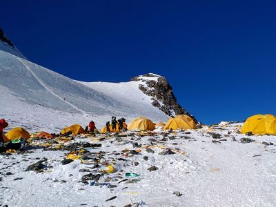 Trash and gearleft behind by climbers litter the ground at Camp 4 on Mount Everest.