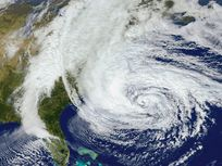 A satellite image of Hurricane Sandy in the Atlantic Ocean off of the east coast of the United States.