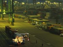 Mobile x-ray system examines containerized cargo being off-loaded from ships in the Port of Los Angeles.