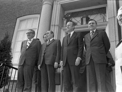 Photograph of Henry Kissinger, Leonid Brezhnev, President Ford, and Andrei Gromyko outside the American Embassy in Helsinki, Finland on July 30, 1975.