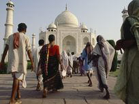 Pilgrims walk toward the Taj Mahal.
