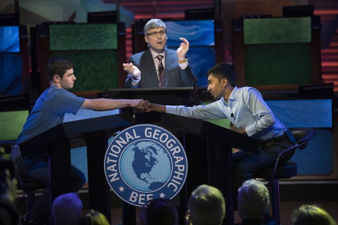 Picture of Pranay Varada and Thomas Wright and host Mo Rocca