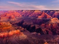 The sun highlights the stratigraphic layers of the Grand Canyon in Arizona in this image.