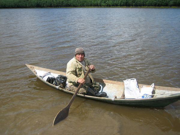 Photo: V. M. Gabov, youngest fluent speaker of Chulym, boating on the Chulym River
