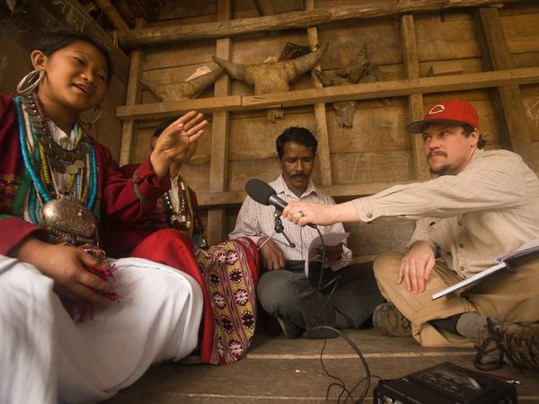 Photo: Greg Anderson and Ganesh Murmu interview a woman (name withheld) from the Aka tribal group