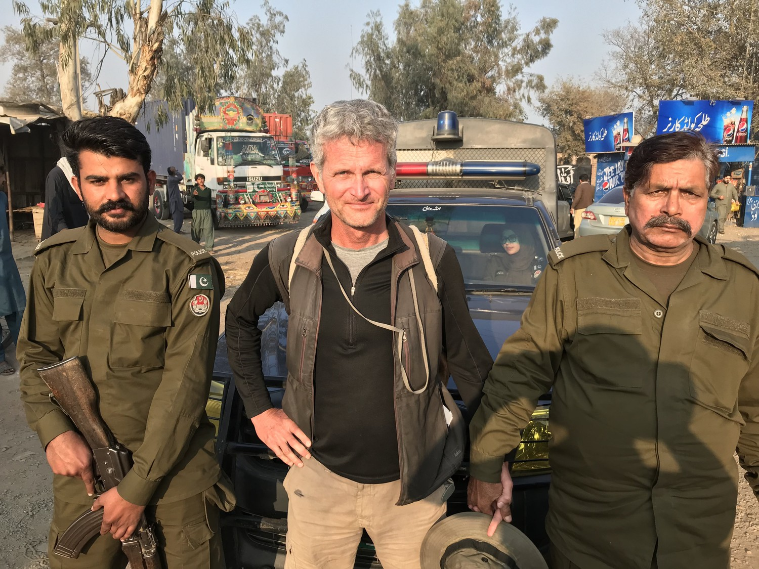 "0e53b64fc116 ""It s for your safety."" Pakistani National Police officers escort Salopek  more than a hundred miles along the Grand Trunk Road—sometimes cruising  hundreds ..."