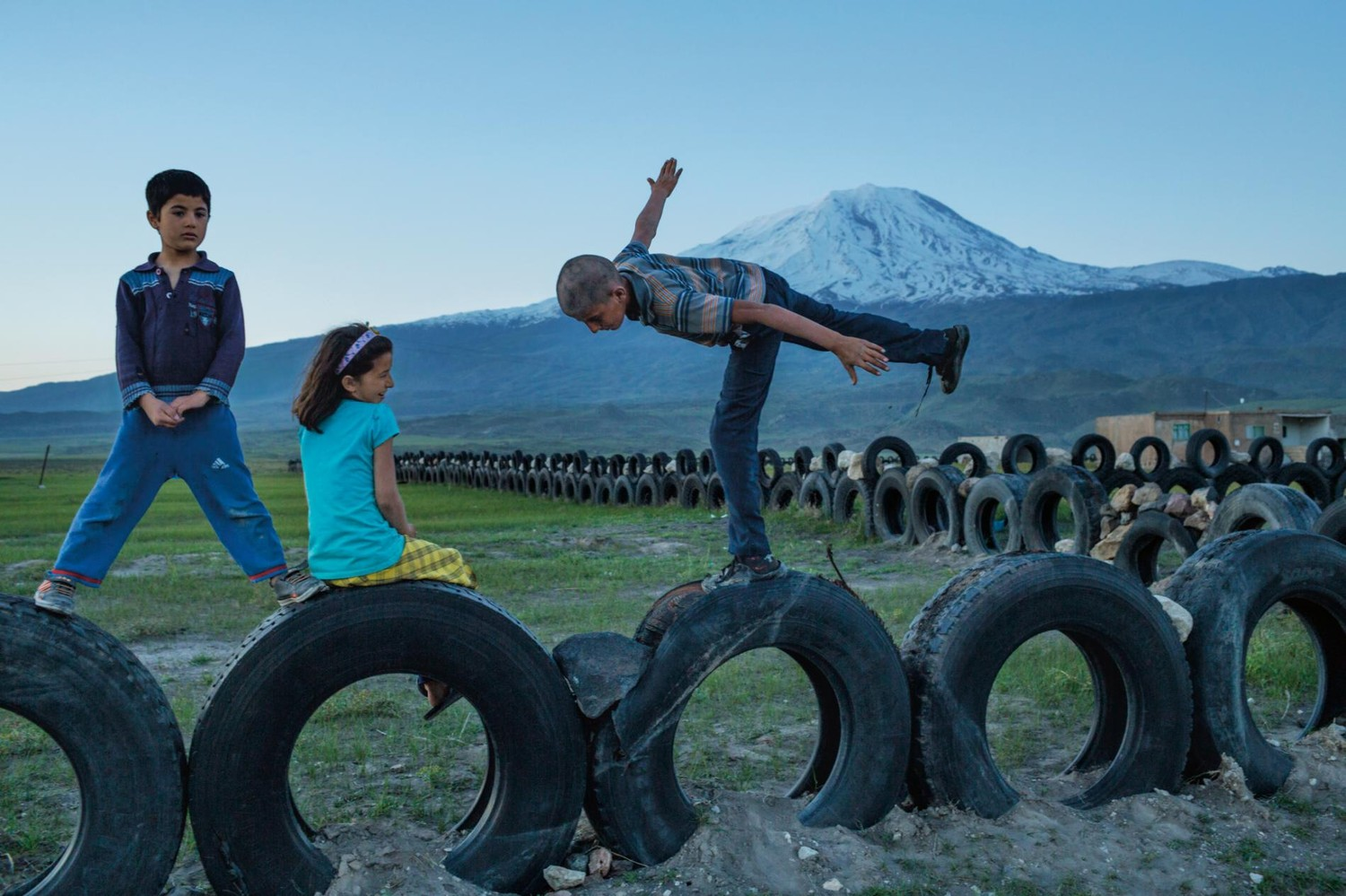Walking through a landscape of pain in the caucasus out of eden walk children in turkey play at the foot of mt ararat a peak of symbolic importance to armenian identity buycottarizona Images